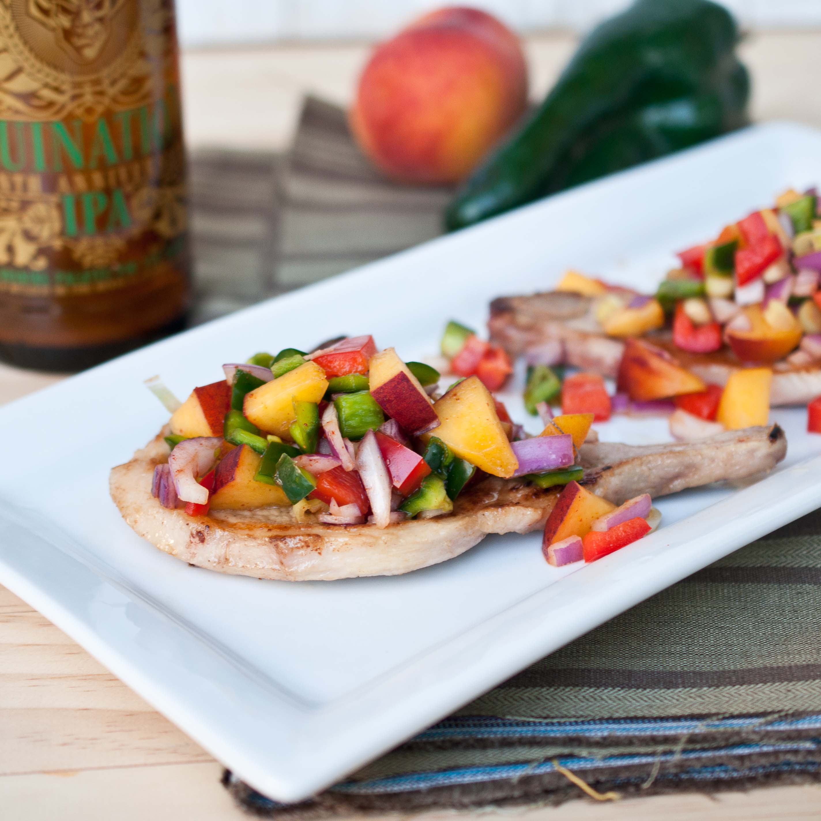 IPA-Marinated Citrus Pork Chops with Peach Poblano Salsa | The Beeroness
